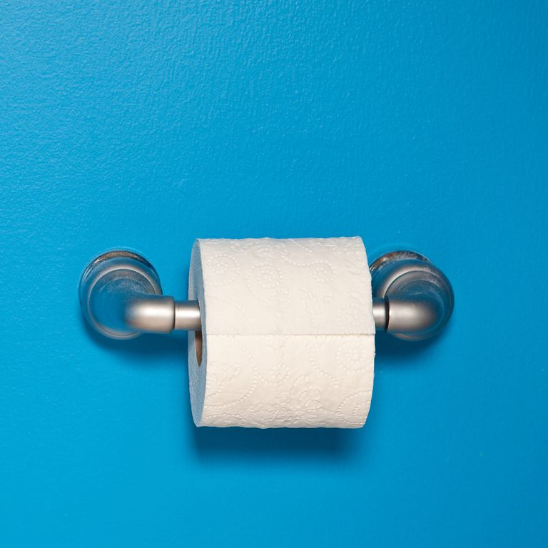 toilet-paper-on-blue-wall-royalty-free-image-485440388-1549992622-2019-03-28-08-59.jpg